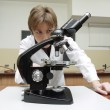 Chemistry teacher with microscope — Stock Photo