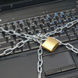 Chained laptop — Stock Photo