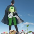 Eco superhero and green plantlet — Stock Photo #23483233
