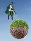 Eco superhero watering dried planet — Stock Photo