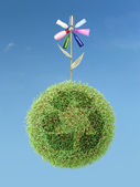 Eco flower on green recycle planet — Stock Photo