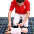 Infant pulse check demonstration — Foto de stock #23491701