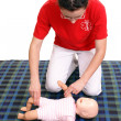 Stock Photo: Infant pulse check demonstration