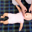 Stok fotoğraf: Infant mouth-to-mouth resuscitation
