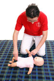 Infant pulse check demonstration — Stock Photo