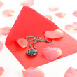 Pearl heart and pink rose petals — Stock Photo