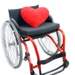 Stock Photo: Red heart and wheelchair