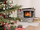 Christmas tree by the fireplace — Stock Photo