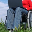 Stock Photo: Handicapped womwith laptop