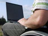 Handicapped man with laptop — Foto de Stock