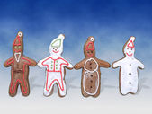 Four gingerbread cookie figures — Stock Photo