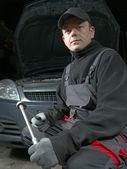 Auto mechanic with socket wrench  — Stock Photo