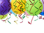 Party balloons and streamers — Stock Photo