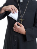 Priest with bribe — Stock Photo