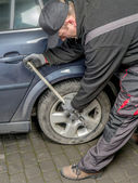 Car tire change — Stock Photo