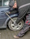 Car tire change — Stock Photo