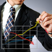 Business man writing graph — Stock Photo