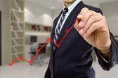 Businessman write red graph — Stock Photo