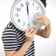 Crazy man holding clock - Stock Photo