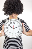 Crazy man holding clock — Stock Photo