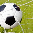 Soccer ball in the goal — Foto Stock