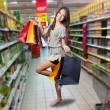 Stock Photo: Asiwomwith shopping bags