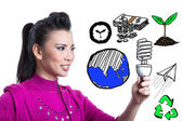 Asian woman holding spiral bulb — Stock Photo