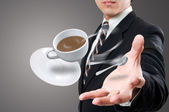 Businessman give to you the coffee cup — Stock Photo