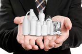 Businessman holding many product with his hand — Stock Photo