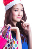 Asian women on holding a lot of shopping bag — 图库照片