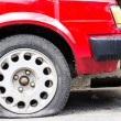 Close up Flat tire on the road waiting — Stock Photo