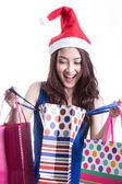 Asian women on holding a lot of shopping bag — Stock Photo