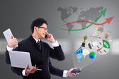 Smart businessman on busy with use many hand hold Electronic com — Stock Photo