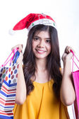 Asian women on holding a lot of shopping bag — Photo