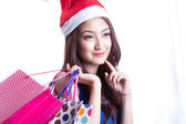 Asian women on holding a lot of shopping bag — Stockfoto