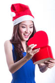 Lovely Asian girl hold gift — Stock Photo