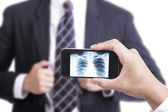Doctor use smart phone check your health — Stock Photo