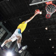 Basketball player layup for score — Stock Photo