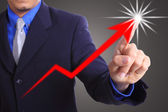 Businessman touching growing graph — Stock Photo