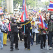 Stock Photo: BANGKOK - DEC 9: Many Masked protesters walked for anti governme