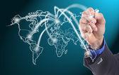 Businessman writing network line — Stock Photo