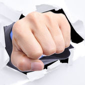 Businessman punch through white paper — Stock Photo