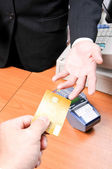 Businessman give credit card for pay something — Stock Photo