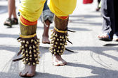 Close up devotee's leg with small bells — Stock Photo
