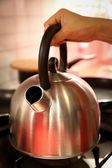 Women hold modle kettle — Stock Photo