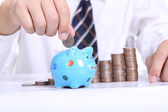 Piggy bank officer put money inside — Stock Photo