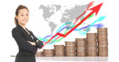 Business women stand in front of growing money graph — Stock Photo