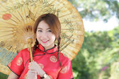 Chinese girl with dress traditional Cheongsam  — Stock Photo