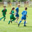 Children playing soccer - Stock Photo