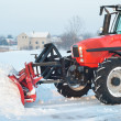 Stock Photo: Tractor cleaning snow